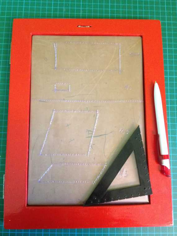Handmade simple drawing board with wooden frame.